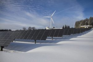 Solar panel field and windmill for green energy goes hand in hand with recycling